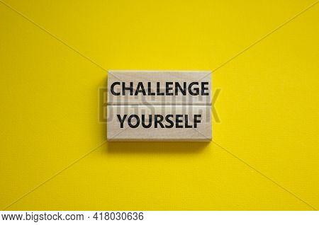 Challenge Yourself Symbol. Wooden Blocks With Words 'challenge Yourself'. Beautiful Yellow Backgroun