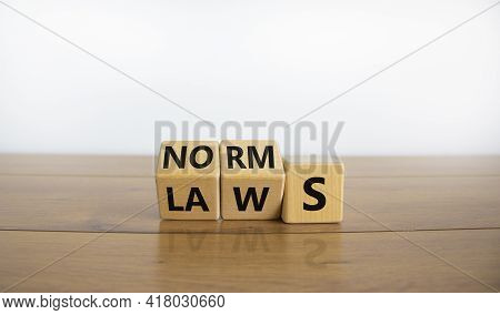 Laws Or Norms Symbol. Turned Cubes And Changed The Word 'norms' To 'laws'. Beautiful Wooden Table, W