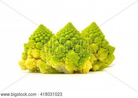 Inflorescence Of Romanesco Broccoli (brassica Oleracea) On A White Background