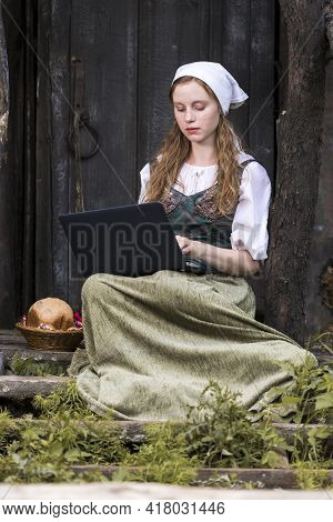 Distant Working Concepts. Portrait Of Young Thinking Ginger Caucasian Girl Working  With Laptop Outd