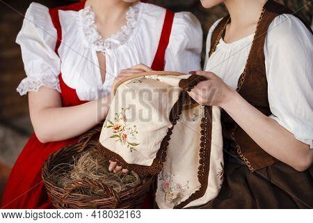 Closeup Of Hands Of Two Caucasian Ladies  Posing With  Fancywork Hoop In Retro Dress In Rural Enviro