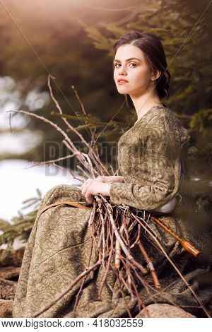 Closeup Portrait Of Sensual Caucasian Female In Village Dress Holding Pieces Of Brushwood In Hands W