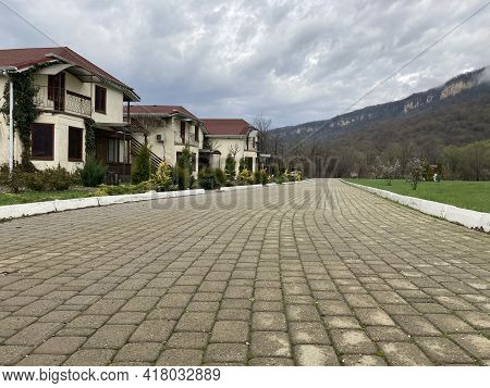 Close Up Of Residential Buildings In Mountainous Terrain. Cottage Houses In Countryside In Cloudy We