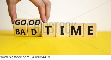 Good Or Bad Time Symbol. Businessman Turns Wooden Cubes And Changes Words 'bad Time' To 'good Time'.