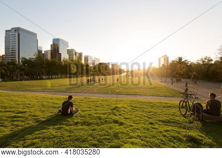 Santiago, Region Metropolitana, Chile - January 17, 2019: People Watching The Sunset At Parque Arauc
