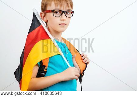 Cute Student Holding German Flag. People, Education, Learning And School Concept. Kid Kearning Germa