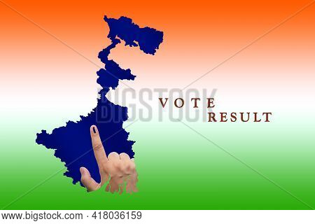 Election Results Background In West Bengal. Indian Voter Hand With Voting Sign Or Ink On His Fingert