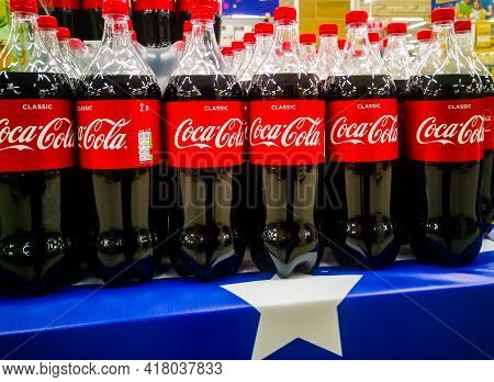 Plastic Two-liter Bottles With A Delicious Carbonated Drink Coca-cola In The Hypermarket On Sale Sin