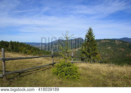 Old Wooden Fence In The Mountains. Forest Mountains Blue Sky. Majestic View On Beautiful Mountains.