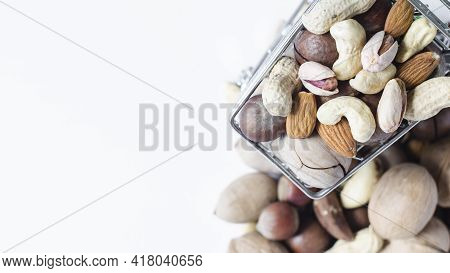 A Cart Full Of Different Nuts And A Mountain Of Nuts On A White Background Assorted Nuts Top View Of