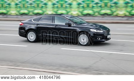 Ford Mondeo Mk5 Goes Fast On The Asphalt Road. Fourth-generation Ford Mondeo In City Street. Moscow,
