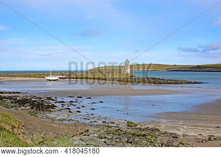 Port Logan Harbour Lighthouse In Galloway, Scotland
