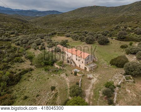 Aerial View Of A Deserted Farm Building Surrounded By Lush Green Maquis At Ifana In Corsica