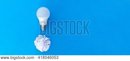 Tablet To Write Down A Person\\\'s Ideas Together With A Disposable Crumpled Paper And A Light Bulb