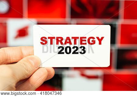 Concept Of Strategy For 2023 In The Hands Of A Businessman On His Business Card