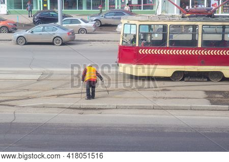 Krasnoyarsk, Russia - March 29, 2021: Tram Driver Manually Moves The Switch On The Tram Rail System