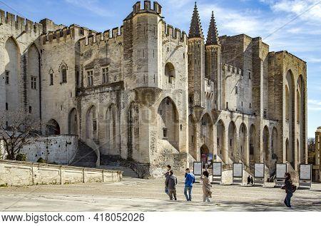 France, Avignon, March, 2021 - Tourists Visiting The Palais Des Papes Dominates The Avignon City, Th
