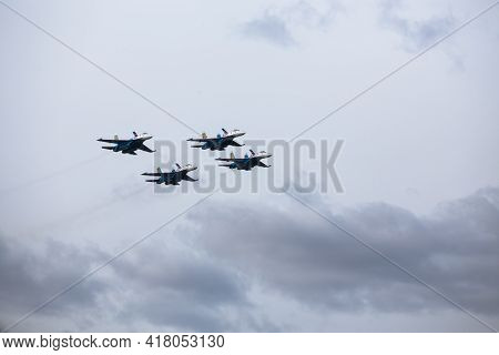 Military Aircraft Fly At Low Altitude Over The Audience During The Air Show. Patriotic Military Holi