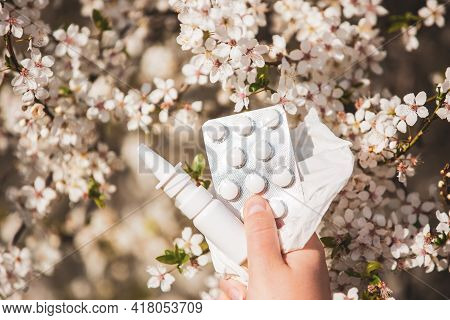 Allergy Concept, Young Woman With Pills Or Drugs And Nose Or Nasal Spray Against The Strong Allergy