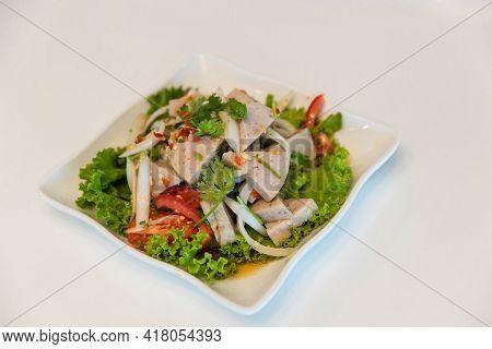 Spicy Vietnamese Sausage Salad On White Background. Spicy Vietnamese Pork Sausage Salad With Vegetab