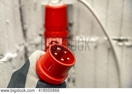 High Voltage Plug In Hand. Connecting A 380 Volt High Voltage, Three Phase Plug To An Outlet. Copy S