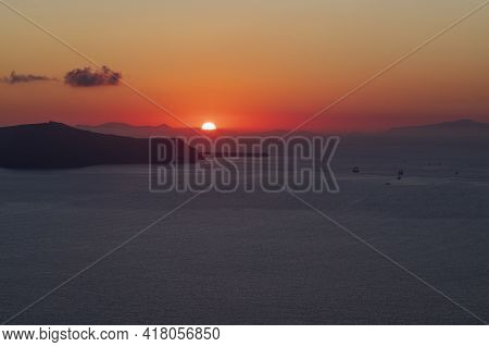 Sunset Over Caldera On Santorini Island In Greece.
