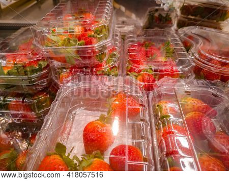 Selling Strawberries In Containers At A Small Grocery Supermarket.