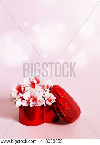 Heart Shape Gift Box And Bouquet On Pink Background.