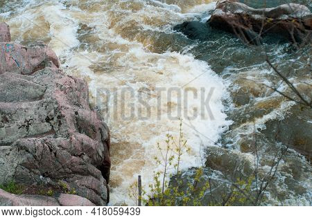 Stormy Stream Mountain River, Rapid Flow Water Close-up Among Stones. Restless Stream Surface With F
