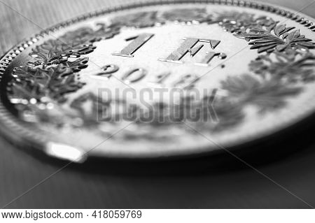1 Swiss Franc Coin Close-up. Black And White Background Or Illustration On An Economic, Business, En
