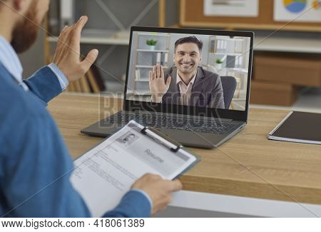 Smiling Employer Or Hiring Manager Greeting Job Candidate In Virtual Job Interview