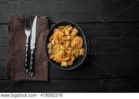 Tasty Appetizing Pasta Spaghetti With Pesto Sauce And Shrimps Set, In Bowl, On Black Wooden Backgrou