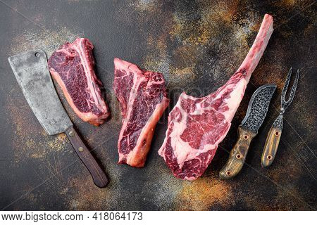 Variety Of Raw Black Angus Prime Dry Aged Meat Steaks Set, Tomahawk, T Bone Or Porterhouse And Club