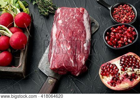 Fresh Raw Beef Tenderloin With Seasonings And Rosemary, A Whole Uncut Piece Set, On Old Butcher Clea