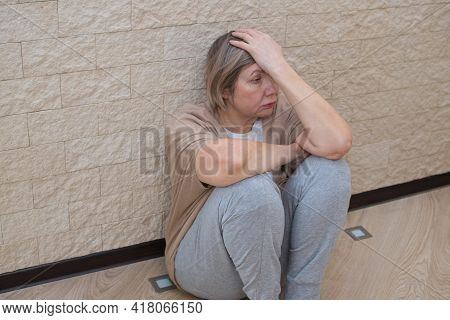 Senior Woman With Depression Stress Sad Sitting On The Floor. The Concept Of Sadness, Loneliness, Ol