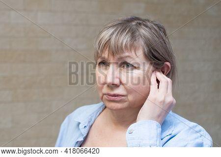 Senior Woman Ear Pain. Tinnitus, Otitis . Ear Infection Health Care Concept.