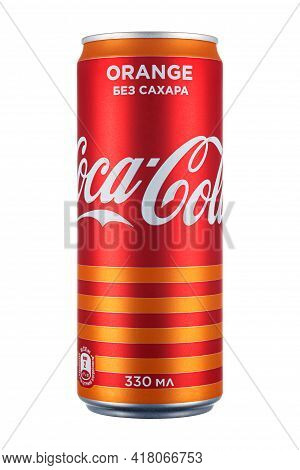 Moscow, Russia - April 07, 2021: Coca-cola Orange Without Sugar In Red Aluminum Can With Orange Stri