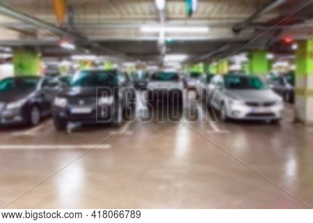 Parking Garage Blurred. Empty Road Asphalt Background In Soft Focus. Car Lot Parking Space In Underg
