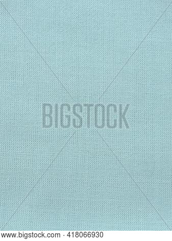 Texture Of Natural Light Green Or Blue Fabric Close-up. The Texture Of The Fabric Is Made Of Natural