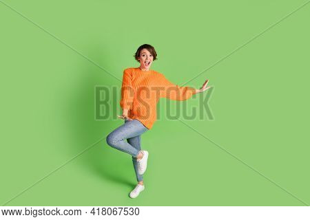Full Length Photo Of Excited Charming Young Lady Happy Funky Dance Weekend Isolated On Green Color B
