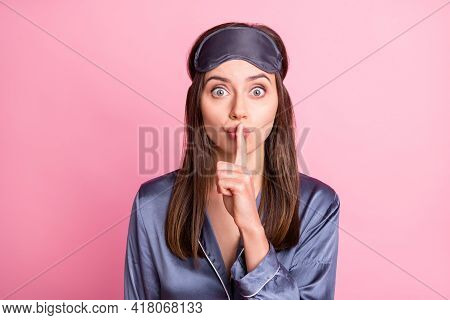 Photo Portrait Of Woman Covering Mouth Lips With Finger Isolated On Pastel Pink Colored Background