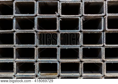 Background of metal profile pipe of rectangular cross section
