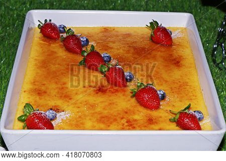Caramelized Vanilla Creme Brulee With Fresh Berries, Sweet French Food Speciality