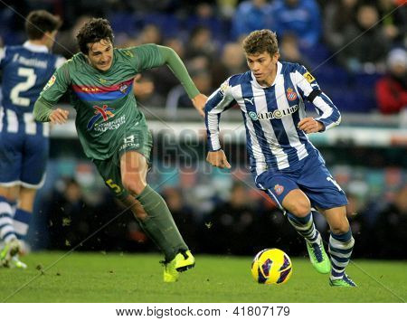 BARCELONA - FEB, 2: Samuele Longo(R) of RCD Espanyol fight with Hector Rodas of UD Levante during a Spanish League match at the Estadi Cornella on February 2, 2013 in Barcelona, Spain