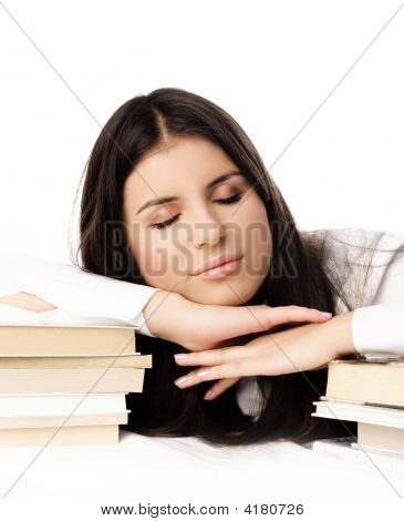 Beautiful Student Sleeping On The Books