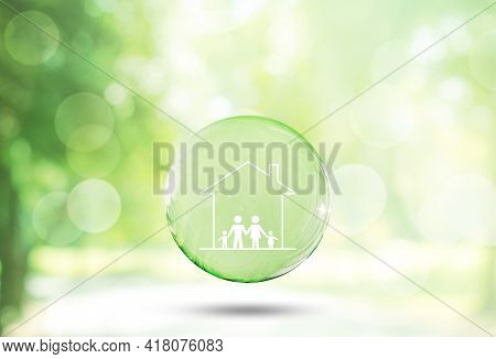Happy Family Concept : Family And Home Icons With Blurry Green Trees And Sunlight In Background.