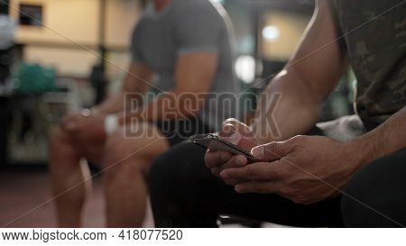 Member In Fitness Gym Using Smartphone Technology Planing Workout, Healthy Lifestyle Bodybuilding, A