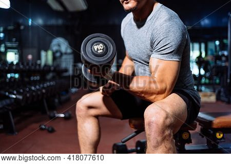 Sport Athlete Man Workout Weight Training With Dumbbell In Fitness Gym Healthy Lifestyle Bodybuildin