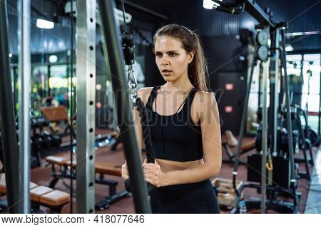Sport Athlete Woman Workout Weight Training With Cable Machine In Fitness Gym Healthy Lifestyle Body