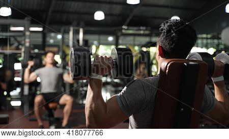 Sport Athlete Man Workout Shoulder Press With Dumbbell In Fitness Gym Healthy Lifestyle Bodybuilding